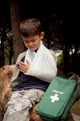 boy with sling - treatment for injuries