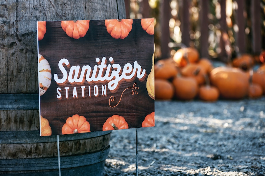halloween during covid-19 - sanitizer station sign at pumpkin patch